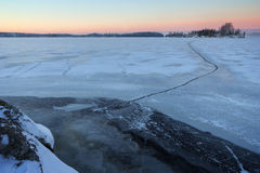 Frozen and snowy lake at morning in Finland Stock Photo