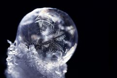 A frozen soap bubble on snow is a beautiful natural work of art Royalty Free Stock Image