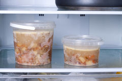 Frozen soup in the refrigerator. Close Stock Photography