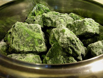 Frozen spinach. Cubes of frozen spinach ready for steam cooking Stock Images