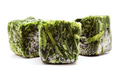Frozen spinach cubes Royalty Free Stock Photos