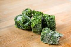 Frozen Spinach pieces Stock Photos
