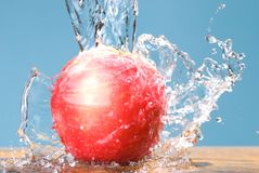 Frozen splash and rose color apple Stock Photography