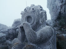 Frozen statue Martian. Frozen metal sculpture of a Martian, on top of Jested Mountain in the Giant Mountains Stock Photography