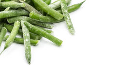 Frozen stcks of asparagus. White background. Isolated. Royalty Free Stock Photography