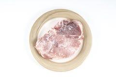 Froken steak. Frozen steak on a plate stock images