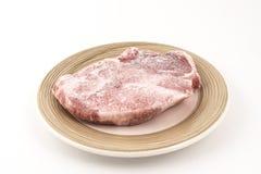 Froken steak. Frozen steak on a plate stock photo