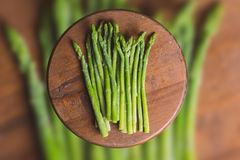 Frozen sticks of asparagus on rustic blurred wood and vegetable background. horizontal view. Frozen sticks of asparagus on rustic blurred wood and vegetable Royalty Free Stock Images