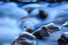 Frozen stones in brook water Stock Photography
