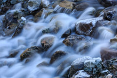 Frozen stones in run of mountain river Royalty Free Stock Image
