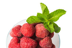 Frozen strawberries and a sprig of fresh mint, top view, isolate Stock Photo