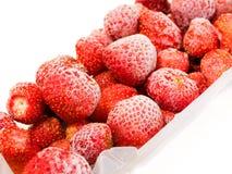 Frozen strawberries. On white background Royalty Free Stock Photo