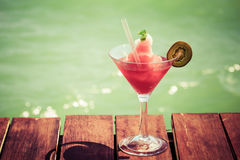 Frozen Strawberry Daiquiri cocktail on the wooden pier. Concept Stock Images