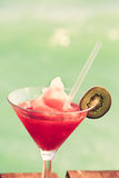 Frozen Strawberry Daiquiri cocktail on the wooden pier. Concept Stock Photo