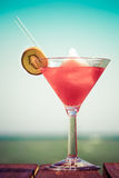 Frozen Strawberry Daiquiri cocktail on the wooden pier. Concept Stock Image