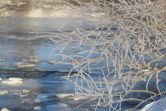 Frozen Stream. A partially frozen stream sparkles in the sunlight on a frosty winter morning Royalty Free Stock Photography