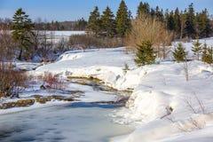 Frozen Stream. Running through farmland in rural Prince Edward Island, Canada Stock Photography