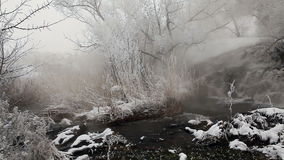 Frozen stream with waterfall and icicles in the winter, Ukraine stock footage