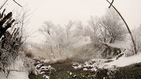 Frozen stream with waterfall and icicles in the winter, Ukraine stock video footage