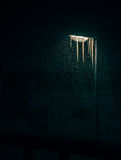 Frozen streetlight at night time. Frozen streetlight with icicles on a cold winter night looking like a jellyfish Royalty Free Stock Photography