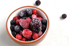 Frozen Summer Berries With Heart-Shaped Raspberry Stock Photos