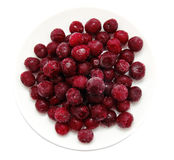 Frozen sweet cherries on white plate Royalty Free Stock Photos