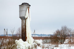 Frozen tank tower in country field Stock Images
