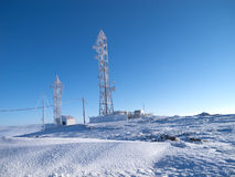 Frozen telecommunications antenna Stock Images