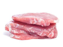 Frozen tenderloin. Some slices of raw tenderloin on a white background Royalty Free Stock Photos