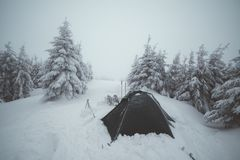 Frozen tents in the high mountain Royalty Free Stock Photo