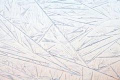 Frozen textured window glass. Macro view frozen ornament Royalty Free Stock Photo
