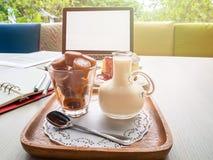 Frozen thai tea in glass and fresh milk Stock Photos