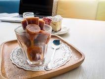 Frozen thai tea with a piece of cake and milk Stock Photos