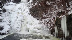 Frozen tiered waterfall covered in beautiful ice