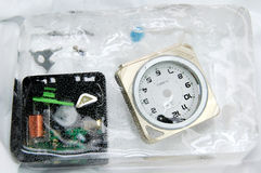 Frozen time. Alarm clock break out showing many plastic components  encapsulated in ice Stock Photography