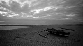 A boat in a low tide sea. This was taken on beach where we went on a holiday to in the Philippines Stock Photography