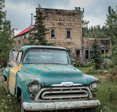 Frozen In Time. An old truck sits outside the remans  of a grocery store at the Kennicott Mine Stock Images