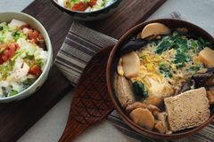 Frozen Tofu Soup & Tofu Mentaiko Donburi. Frozen tofu braised with fish flesh and mushrooms, and topped with beaten eggs and greens Stock Photo