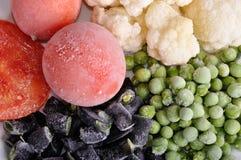 Frozen tomato, asparagus, peas and cauliflower Stock Image