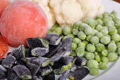 Frozen tomato, asparagus, peas and cauliflower Royalty Free Stock Photos