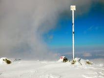Frozen trail post Stock Photo