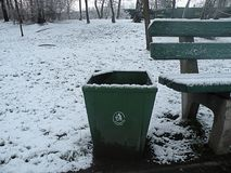 Frozen a trash can and bench Stock Photo