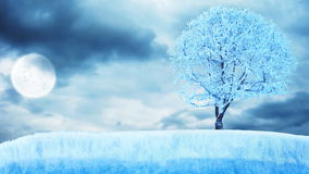 Frozen tree on ice under moon with clouds Royalty Free Stock Photo