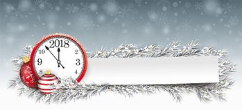 Paper Banner Bauble Frozen Twigs Christmas Clock 2018. Frozen twigs, red bauble and paper sticker with the red clock and date 2018 Royalty Free Stock Photos