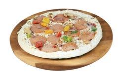 Frozen uncooked pizza Stock Photo