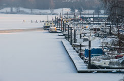 Frozen up harbor port icebound boats ships winter snow ice Stock Photos