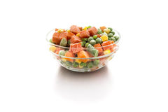 Frozen Vegetable. Bowl of mix frozen vegetable on a white background Stock Images