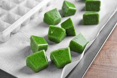 Frozen vegetable puree and ice tray Royalty Free Stock Photo