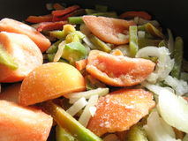 Frozen vegetables. On the frying pan Royalty Free Stock Photography