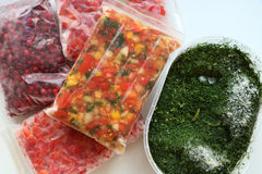 Frozen vegetables and berries. Frozen vegetables are ready to provide you vitamins durring winter. Make freezing in vacuum bags or plastic box and enjoy summer Stock Photos